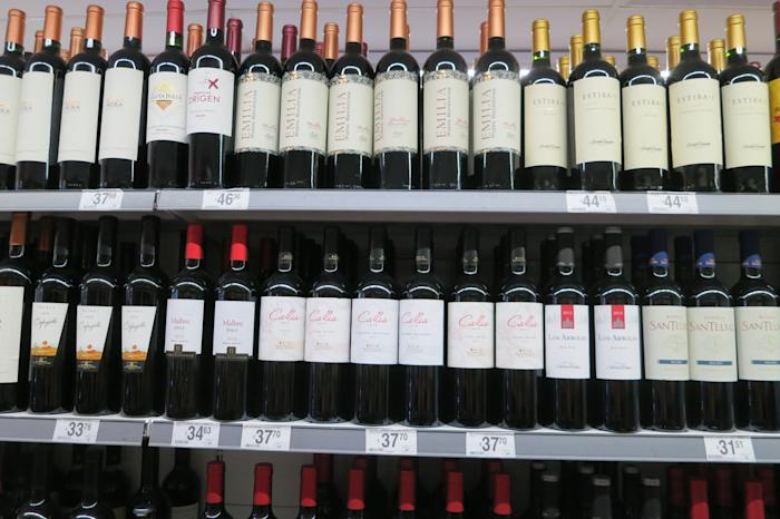 Rows of red wine in a supermarket in Argentina. Want to spend $5 on your next cup of Starbucks? Why not save it for a bottle of Argentinian Malbec at less than $5 when you're there?