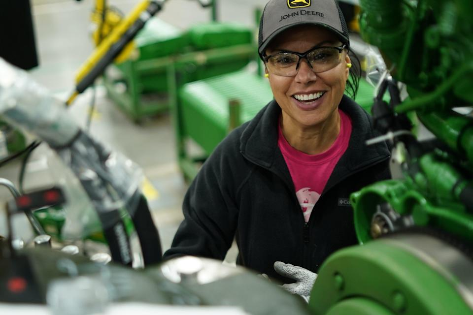 Jo Wilson, a Waterloo Works employee for ten years, marries the engine to the transaxle on the 7 Series Chassis Line.