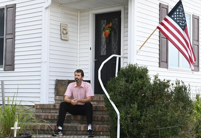 Everett Landon is leading the charge get Smith Island's last remaining vote precinct back. Landon grew up on Smith Island, and has spent his life as a Methodist pastor. Now he's trying to try to preserve the island's way of life. He's pictured here sitting on the front porch of his home on Smith Island, Maryland.