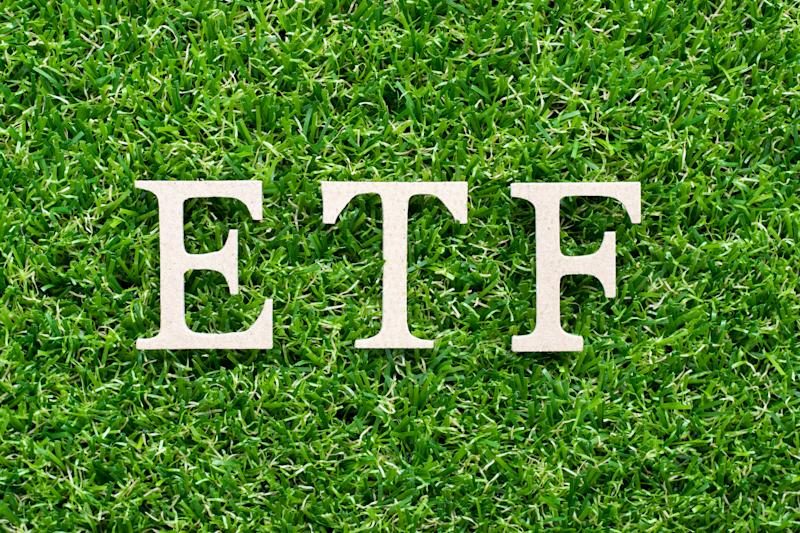 The acronym ETF on a bed of grass