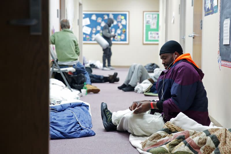 People take shelter at a Salvation Army facility after winter weather caused electricity blackouts in Plano.