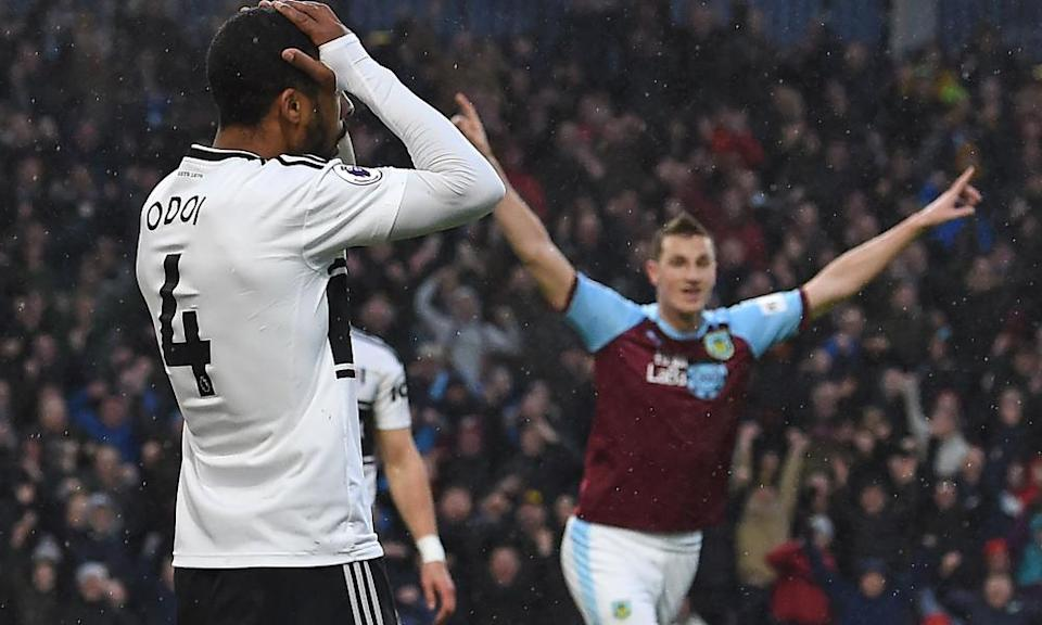 Burnley's Chris Wood reacts after Fulham defender Denis Odoi put through his own net.