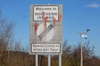 Signage welcoming motorists from the Irish Republic into Northern Ireland is pictured on the main Dublin/Belfast motorway near Newry on January 1, 2021, as Britain begins life outside the European Union. - In Northern Ireland, the border with Ireland will be closely watched to ensure movement is unrestricted - key to a 1998 peace deal that ended 30 years of violence over British rule as Britain on Friday began a new year and life outside the European Union after leaving the bloc's single market. (Photo by Paul Faith / AFP) (Photo by PAUL FAITH/AFP via Getty Images)