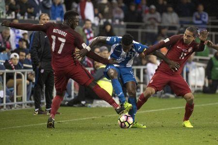 March 24, 2017; San Jose, CA, USA; Honduras midfielder Romell Quioto (12) fights for the ball against United States forward Jozy Altidore (17) and midfielder Alejandro Bedoya (11) during the first half of the Men's World Cup Soccer Qualifier at Avaya Stadium. Mandatory Credit: Kyle Terada-USA TODAY Sports