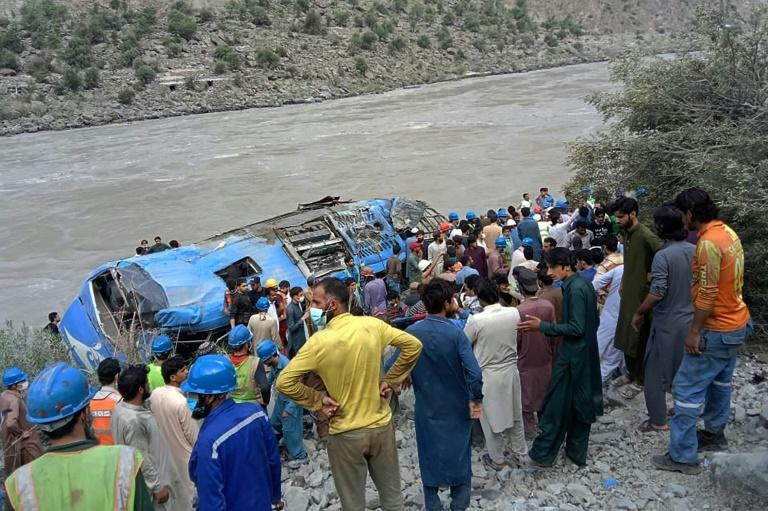 Rescuers and onlookers gather around a a bus that plunged into a ravine following what Beijing called a bomb explosion, killing 12 people including nine Chinese workers, in Kohistan district of Pakistan's Khyber Pakhtunkhwa province, July 14, 2021