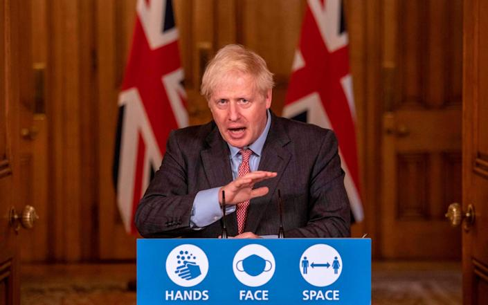 Britain's Prime Minister Boris Johnson speaks at a remote press conference to update the nation on the Covid-19 pandemic - AFP
