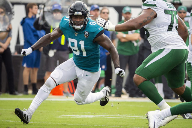 FILE - In this Oct. 27, 2019, file photo, Jacksonville Jaguars defensive end Yannick Ngakoue (91) rushes New York Jets quarterback Sam Darnold (14) during the first half of an NFL football game, in Jacksonville, Fla. Ngakoue made another public plea to be traded, this one on his 25th birthday. Ngakoue said in a Twitter post Tuesday, March 31, 2020, why hold a man from taking care of his family. Its obvious my time is up in my current situation. Lets both move on. (AP Photo/Stephen B. Morton, File)