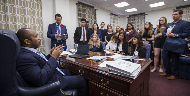 <p>Sen. Bobby Powell talks with survivors from Marjory Stoneman Douglas High School and other students from Broward County, Fla. high schools in his office at the Florida Capital in Tallahassee, Fla., Feb 20, 2018.Students from Marjory Stoneman Douglas High School,, where a shooting left 17 dead, are in Tallahassee channeling their anger and sadness into action. (Photo: Mark Wallheiser/AP) </p>