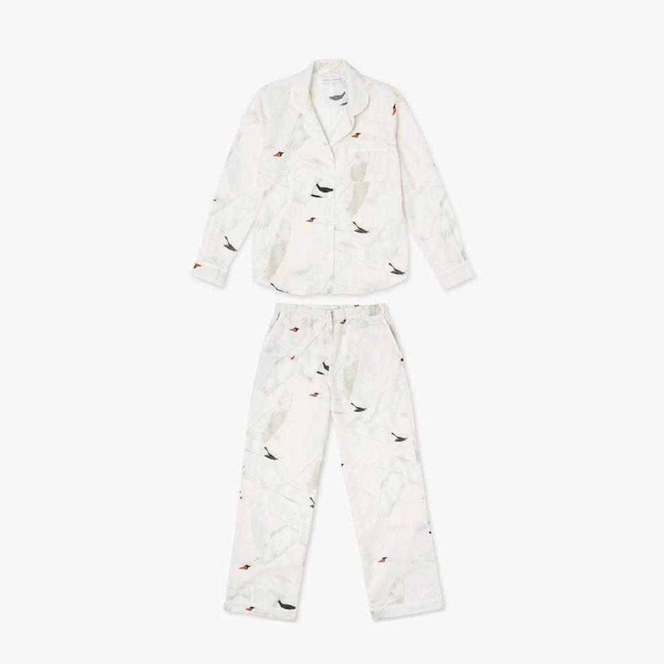 """Stock up on a pair of Desmond & Dempsey's printed pajamas just in time for fall. $197, DESMOND & DEMPSEY. <a href=""""https://desmondanddempsey.com/collections/womens-new-arrivals/products/long-pyjama-set-cygnus-swan-print-cream-women"""" rel=""""nofollow noopener"""" target=""""_blank"""" data-ylk=""""slk:Get it now!"""" class=""""link rapid-noclick-resp"""">Get it now!</a>"""