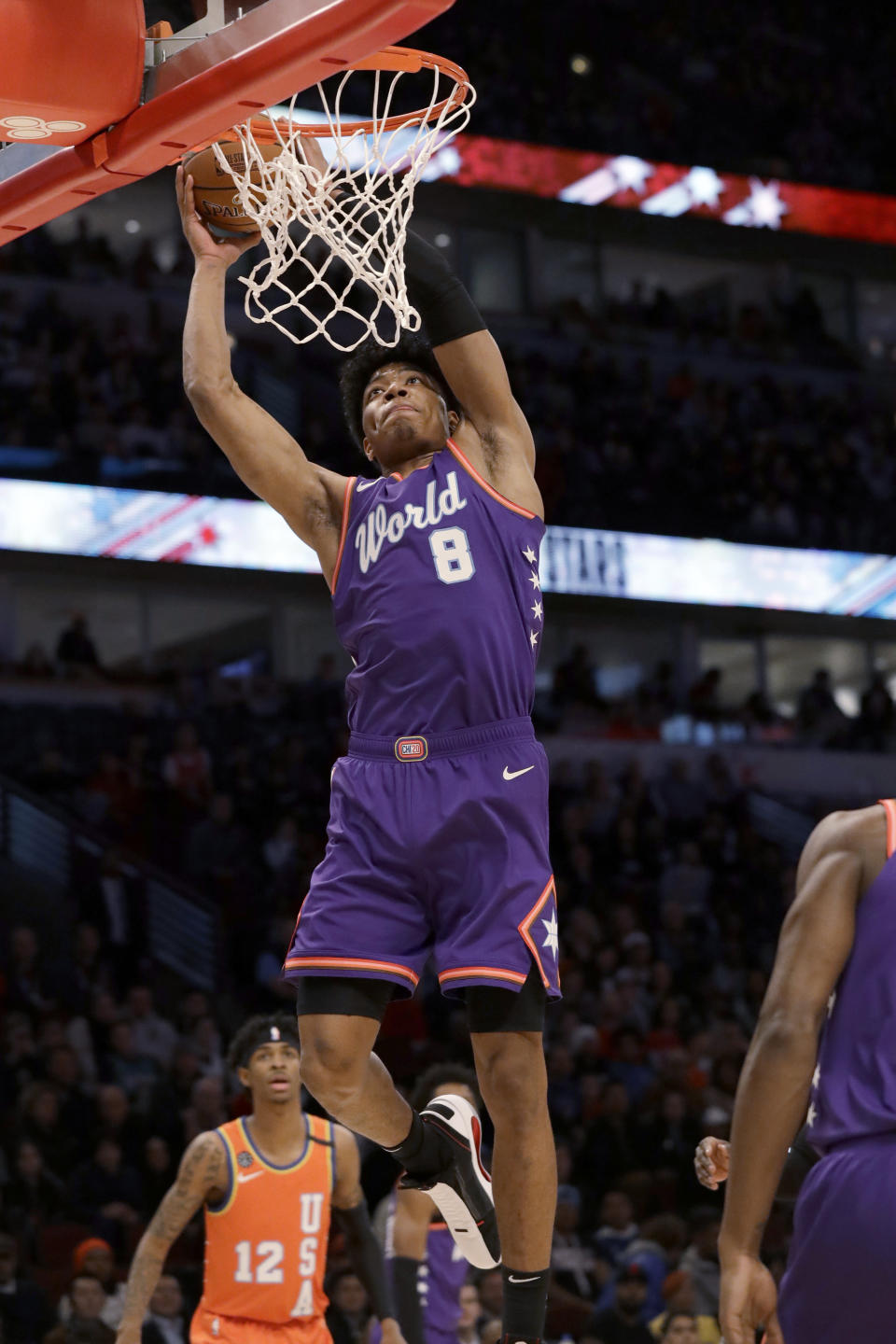 World forward Rui Hachimura, of the Washington Wizards, goes up for a dunk against the United States during the first half of the NBA Rising Stars basketball game in Chicago, Friday, Feb. 14, 2020. (AP Photo/Nam Y. Huh)