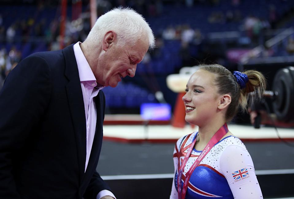 Barry Herne chairman of Matchroom Sport talks to Great Britain's Amy Tinkler after the women's competition during the World Cup of Gymnastics at The O2, London. (Photo by Steven Paston/PA Images via Getty Images)