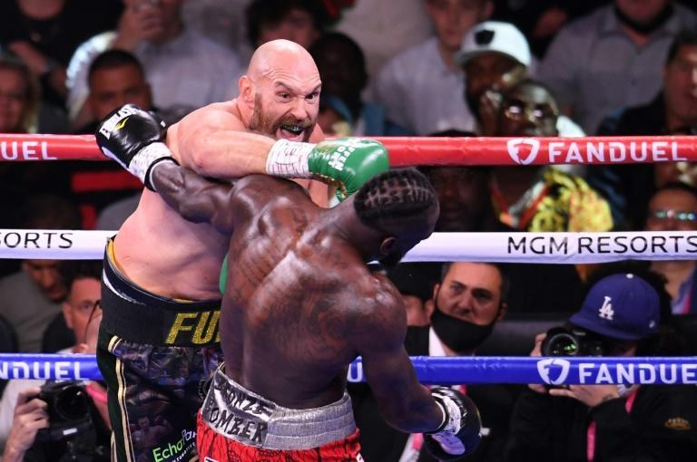 Britain's WBC heavyweight champion Tyson Fury lands an early punch on the way to an 11th-round knockout of US challenger Deontay Wilder (AFP/Robyn Beck)