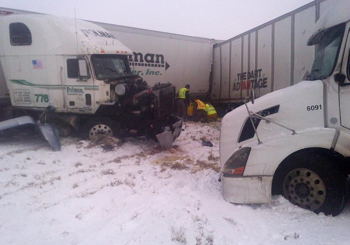 CORRECTS NUMBER DEAD TO TWO INSTEAD OF THREE, AND LOCATION OF ACCIDENT TO INTERSTATE 35 INSTEAD OF INTERSTATE 80 - This photo provided by the Iowa State Patrol shows the scene of a 25-vehicle pileup that killed two people and injured several others Thursday, Dec. 20, 2012 on Interstate 35 about 60 miles north of Des Moines, Iowa. Authorities say poor visibility caused the accident when drivers were unable to see vehicles that had slowed or stopped, causing a chain reaction of crashes. (AP Photo/Iowa State Patrol)