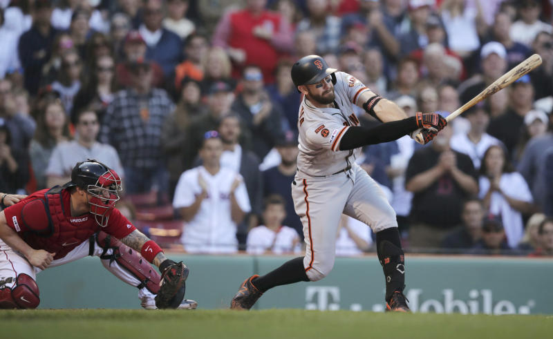 San Francisco Giants' Evan Longoria, right, strikes out swinging with bases loaded to end the ninth inning and a baseball game against the Boston Red Sox at Fenway Park in Boston, Thursday, Sept. 19, 2019. Red Sox catcher Christian Vazquez, left, looks on. (AP Photo/Charles Krupa)