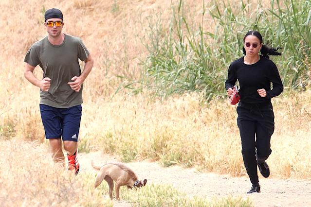 <p>The couple worked on their fitness together with a hike in Malibu, Calif. Of course, they brought along their dog! (Photo: BACKGRID)<br><br></p>