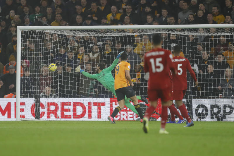 WOLVERHAMPTON, ENGLAND - JANUARY 23: Raul Jimenez of Wolverhampton Wanderers scores a goal to make it 1-1 during the Premier League match between Wolverhampton Wanderers and Liverpool FC at Molineux on January 23, 2020 in Wolverhampton, United Kingdom. (Photo by James Baylis - AMA/Getty Images)