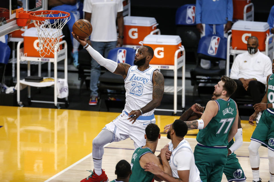 Los Angeles Lakers' LeBron James (23) goes up for a layup against the Dallas Mavericks during the first half of an NBA basketball game Friday, Dec. 25, 2020, in Los Angeles. (AP Photo/Ringo H.W. Chiu)