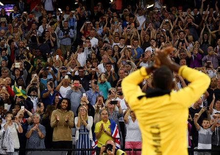 Athletics - World Athletics Championships - London Stadium, London, Britain – August 13, 2017. Usain Bolt of Jamaica applauds fans during a lap of honour. REUTERS/Dylan Martinez