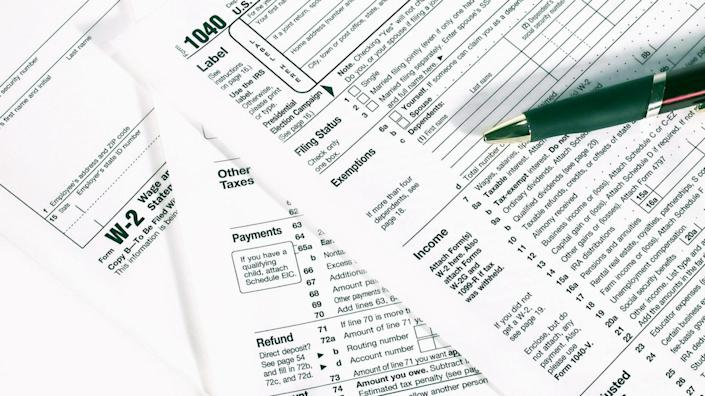 Federal tax forms 1040 and W-2 from the US Department of the Treasury.