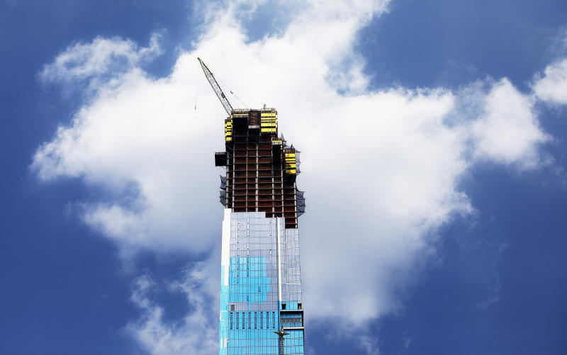 In this July 31, 2019 photo, the Central Park Tower is under construction in New York. (AP Photo/Mark Lennihan)