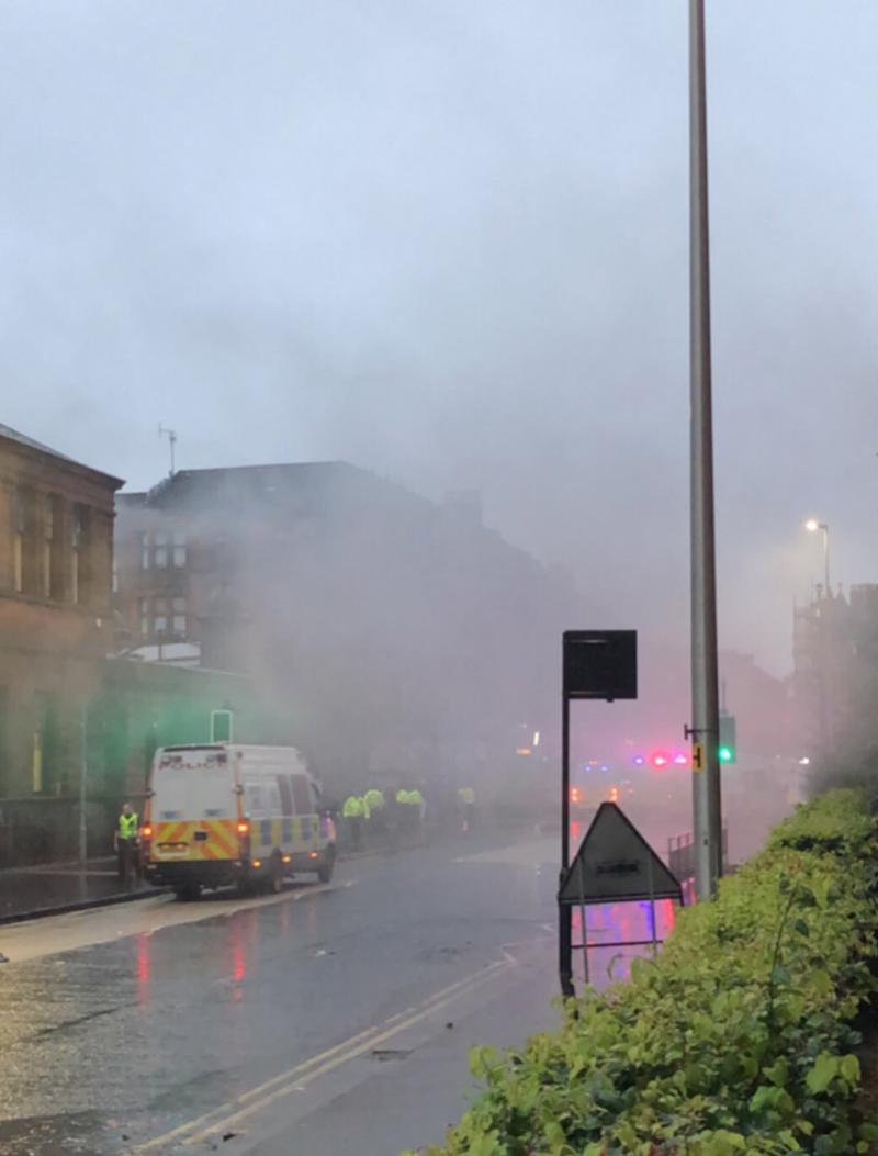 Smoke flares from Govan Road, Glasgow during trouble at an Irish unity march and counter protest (Picture: PA)