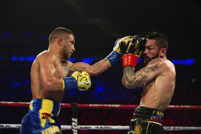 Vasiliy Lomachenko got the better of Jorge Linares on May 12 at Madison Square Garden in New York despite suffering a shoulder injury early in the fight. (AP Photo)