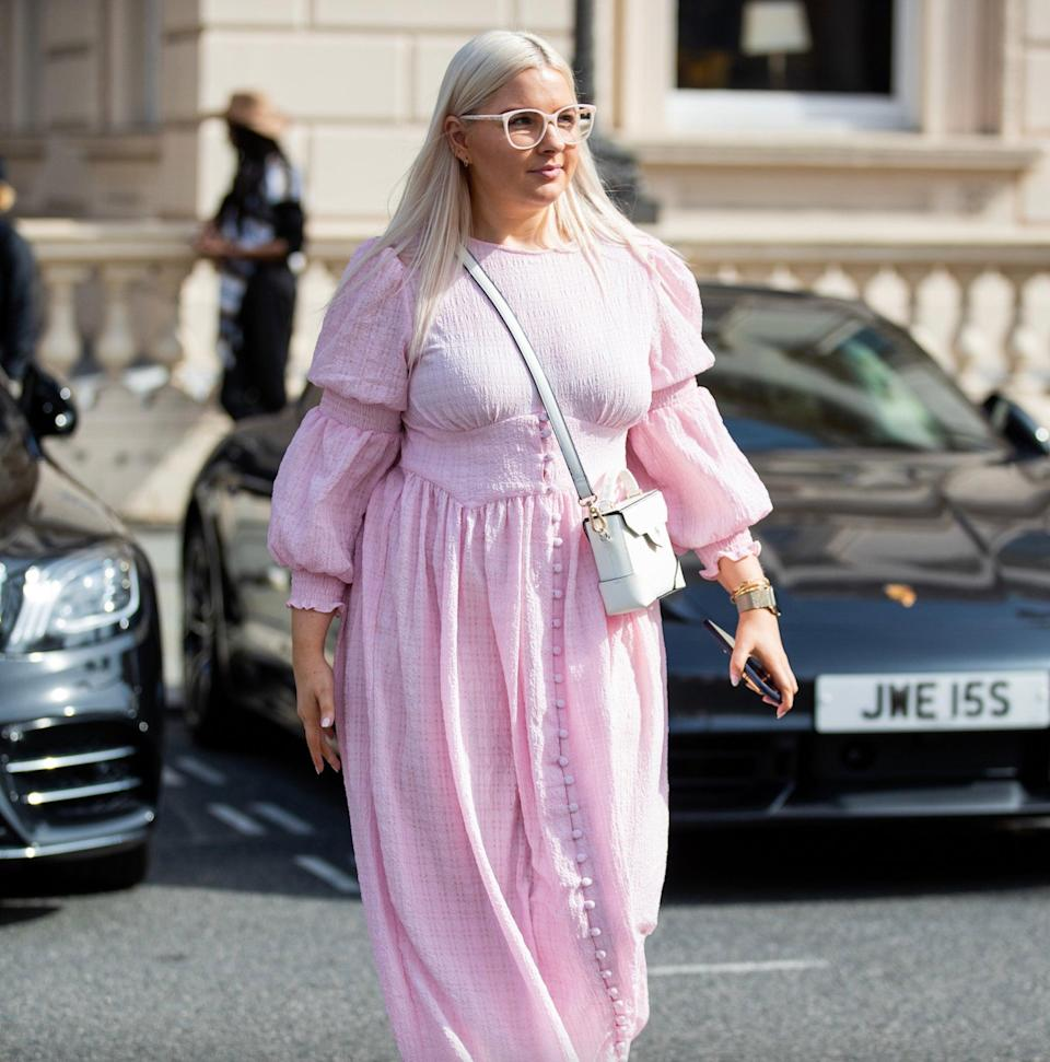 """This blossom-coloured dress with statement sleeves toasts the last of the summer sun, paired with perfectly matching glasses.<span class=""""copyright"""">Photo Courtesy of Christian Vierig/Getty Images.</span>"""