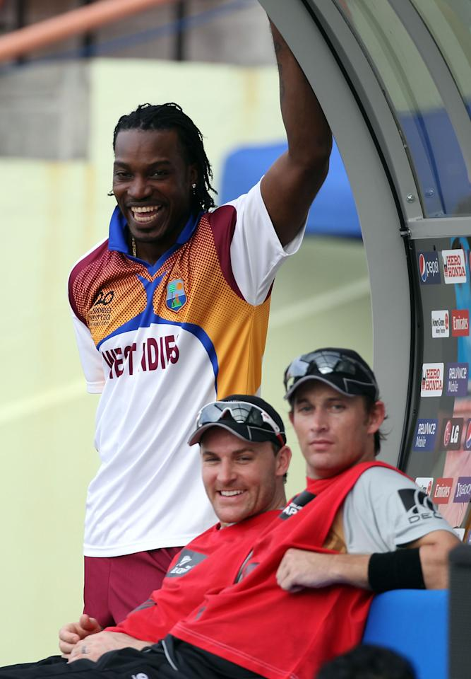 PROVIDENCE, GUYANA - APRIL 27:  Chris Gayle of West Indies shares a joke with Brendon McCullum and Shane Bond of New Zealand during The ICC T20 World Cup warm up match between Ireland and New Zealand at The Guyana National Stadium Cricket Ground on April 27, 2010 in Providence, Guyana.  (Photo by Clive Rose/Getty Images)