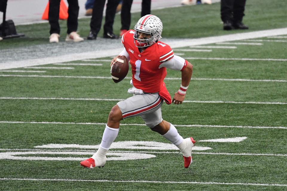 Ohio State QB Justin Fields still has some work to do to solidify his draft slot in the first few picks. (Photo by Jamie Sabau/Getty Images)