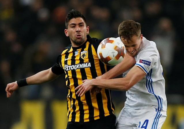 Soccer Football - Europa League Round of 32 First Leg - AEK Athens vs Dynamo Kiev - OAKA Spiros Louis, Athens, Greece - February 15, 2018 AEK's Anastasios Bakasetas in action with Dynamo Kiev's Tomasz Kedziora REUTERS/Alkis Konstantinidis