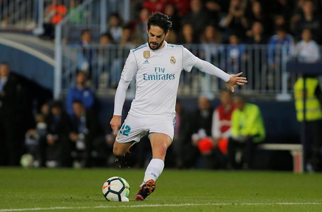 Soccer Football - La Liga Santander - Malaga CF vs Real Madrid - La Rosaleda, Malaga, Spain - April 15, 2018 Real Madrid's Isco scores their first goal from a free kick REUTERS/Jon Nazca