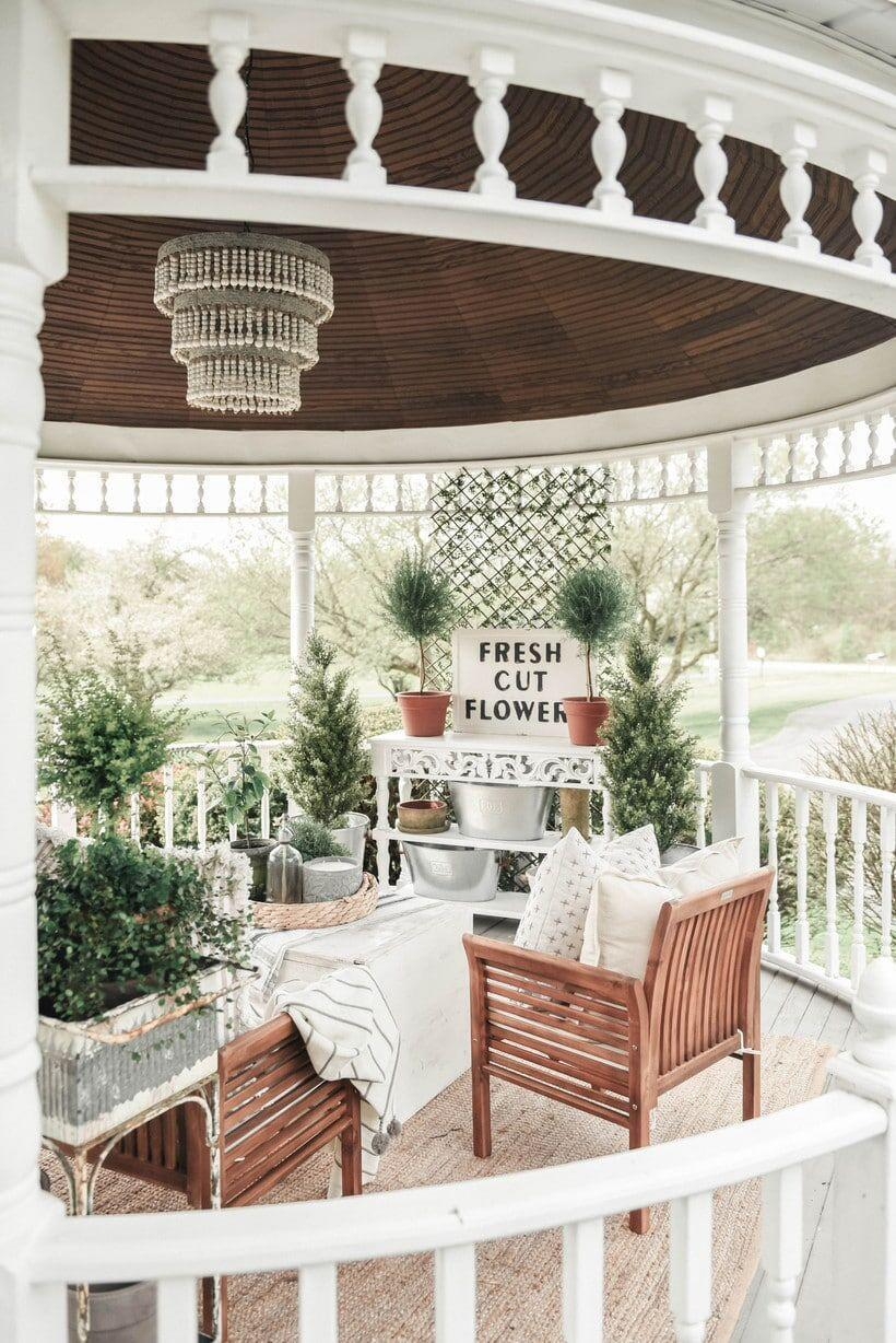 """<p>The focal point of this rustic glam gazebo is a stunning whitewash wood beaded chandelier, but the real beauty is in the details. Check out this makeover for tips on how to make your gazebo lounge area more inviting with plants and neutral touches. </p><p><strong>Get the look at <a href=""""https://www.lizmarieblog.com/2017/05/front-porch-gazebo-makeover/"""" rel=""""nofollow noopener"""" target=""""_blank"""" data-ylk=""""slk:Liz Marie Blog"""" class=""""link rapid-noclick-resp"""">Liz Marie Blog</a>. </strong></p><p><a class=""""link rapid-noclick-resp"""" href=""""https://www.amazon.com/Creative-Co-op-3-Tier-Chandelier-Hanging/dp/B00MTOAHNU?tag=syn-yahoo-20&ascsubtag=%5Bartid%7C10050.g.30932979%5Bsrc%7Cyahoo-us"""" rel=""""nofollow noopener"""" target=""""_blank"""" data-ylk=""""slk:SHOP BEADED CHANDELIERS"""">SHOP BEADED CHANDELIERS</a></p>"""
