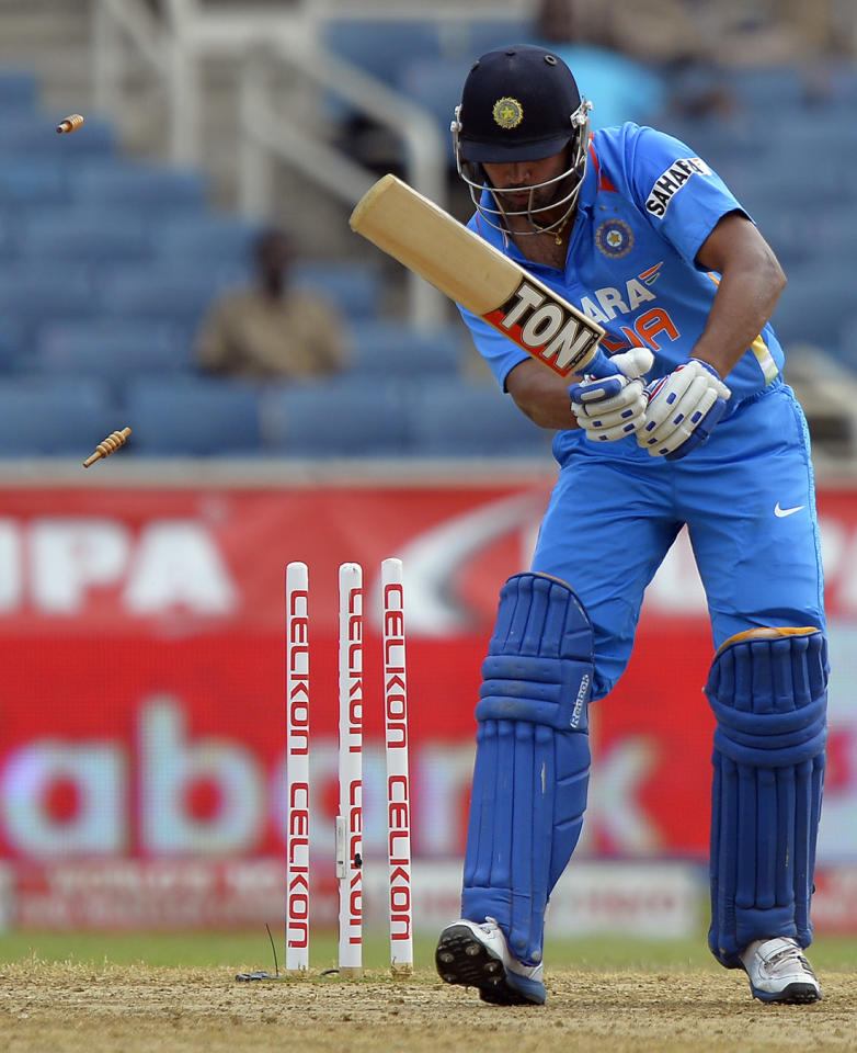 Indian batsman Murali Vijay is clean bowled off Sri Lankan bowler Lasith Malinga during the third match of the Tri-Nation series between India and Sri Lanka at the Sabina Park stadium in Kingston on July 2, 2013. Sri Lanka have scored 348/1 at the end of their innings. AFP PHOTO/Jewel Samad