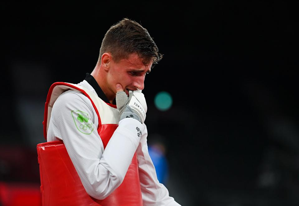 Tokyo , Japan - 24 July 2021; Jack Woolley of Ireland reacts after defeat to Lucas Lautaro Guzman of Argentina in the men's -58Kg taekwondo round of 16 at the Makuhari Messe Hall during the 2020 Tokyo Summer Olympic Games in Tokyo, Japan. (Photo By Brendan Moran/Sportsfile via Getty Images)