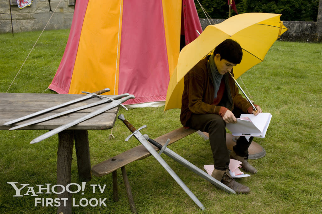 Colin Morgan studies his lines on a rainy on-location day during the filming of the first season of Merlin.
