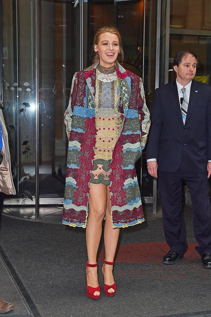 <p>Every so often, Blake comes out and surprises us with a daring outfit combo – but she always pulls it off. Her Valentino dress and jacket looks great paired with an understated ponytail.<br><i>[Photo: Getty]</i> </p>
