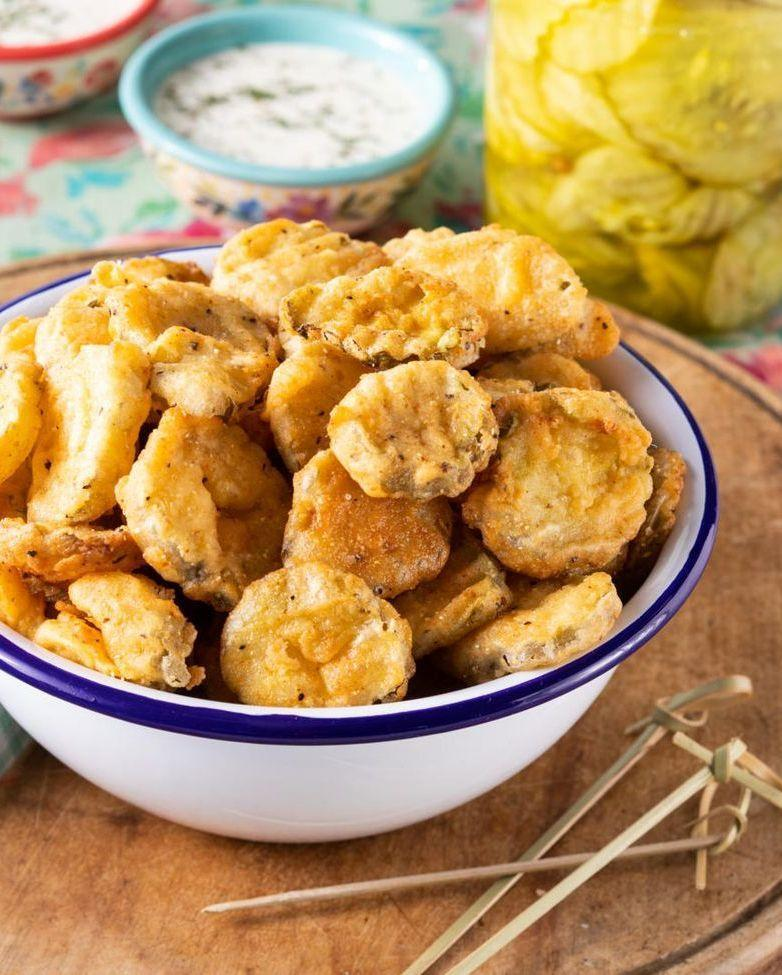 """<p>When any old appetizer just won't do, look to fried pickles. These crunchy bites have just the right amount of tang.</p><p><strong><a href=""""https://www.thepioneerwoman.com/food-cooking/recipes/a35880840/fried-pickles-recipe/"""" rel=""""nofollow noopener"""" target=""""_blank"""" data-ylk=""""slk:Get the recipe"""" class=""""link rapid-noclick-resp"""">Get the recipe</a>.</strong></p><p><a class=""""link rapid-noclick-resp"""" href=""""https://go.redirectingat.com?id=74968X1596630&url=https%3A%2F%2Fwww.walmart.com%2Fbrowse%2Fhome%2Ftools-gadgets%2Fthe-pioneer-woman%2F4044_623679_133020%2FYnJhbmQ6VGhlIFBpb25lZXIgV29tYW4ie&sref=https%3A%2F%2Fwww.thepioneerwoman.com%2Ffood-cooking%2Fmeals-menus%2Fg32157273%2Ffourth-of-july-appetizers%2F"""" rel=""""nofollow noopener"""" target=""""_blank"""" data-ylk=""""slk:SHOP KITCHEN TOOLS"""">SHOP KITCHEN TOOLS</a></p>"""