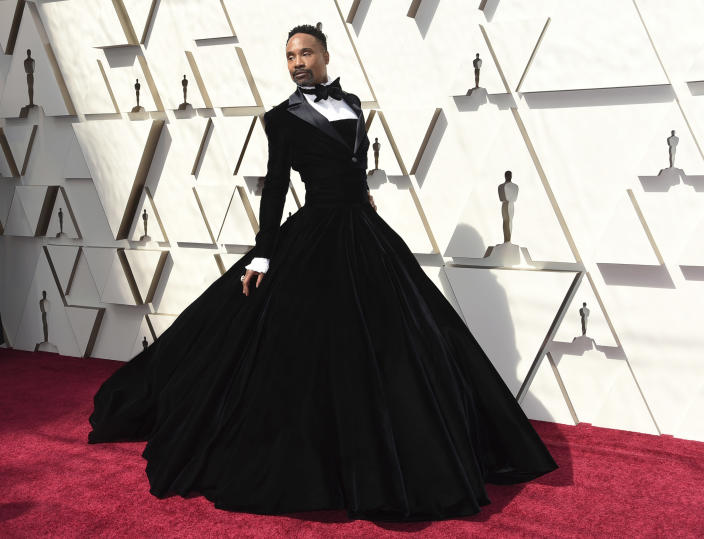 """FILE - Billy Porter arrives at the Oscars in Los Angeles on Feb. 24, 2019. Porter has broken his silence over his HIV diagnosis, saying he no longer wants to live under a cloud of shame. The """"Pose"""" star said in an interview published Wednesday in The Hollywood Reporter that he told nearly no one for 14 years, fearing retaliation and marginalization in his industry. (Photo by Richard Shotwell/Invision/AP, File)"""