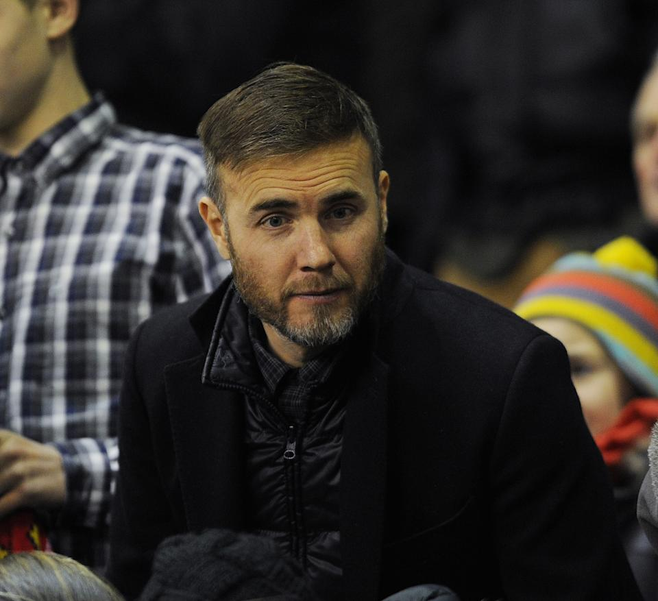 Gary Barlow watches the Barclays Premier League match between Liverpool and Swansea City at Anfield on December 29, 2014 in Liverpool, England.  (Photo by John Powell/Liverpool FC via Getty Images)