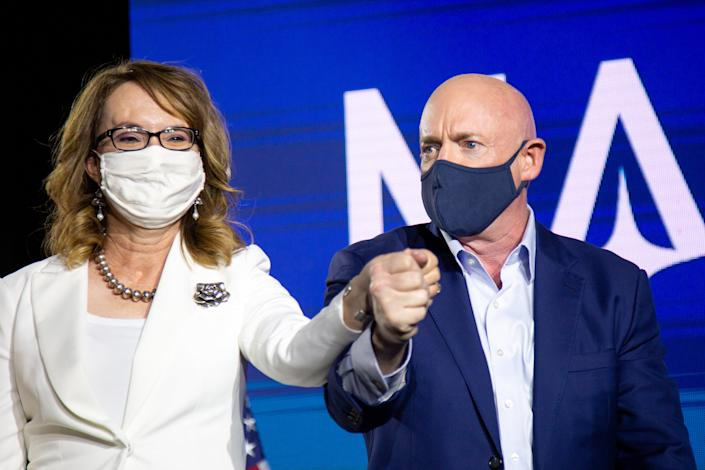 <p>Democratic US Senate candidate Mark Kelly and former Arizona congresswoman Gabrielle Giffords hold hands during the Election Night event</p> (Getty Images)