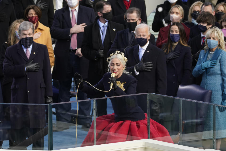 Lady Gaga performs the National Anthem during the 59th Presidential Inauguration at the U.S. Capitol in Washington, Wednesday, Jan. 20, 2021. (AP Photo/Andrew Harnik)