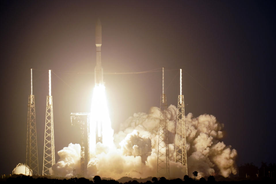 A United Launch Alliance Atlas V rocket carrying a classified spacecraft payload for the U.S. National Reconnaissance Office lifts off from Complex 41 at the Cape Canaveral Air Force Station, Friday, Nov. 13, 2020, in Cape Canaveral, Fla. (AP Photo/John Raoux)