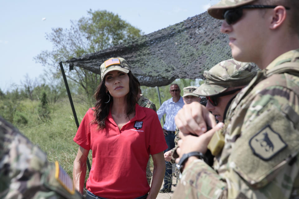 South Dakota Gov. Kristi Noem visits the U.S. border with Mexico on Monday, July 26, 2021, near McAllen, Texas. The Republican governor deployed roughly 50 National Guard troops to help with Texas' push to arrest people crossing illegally and charge them with state crimes. (AP Photo/Stephen Groves)