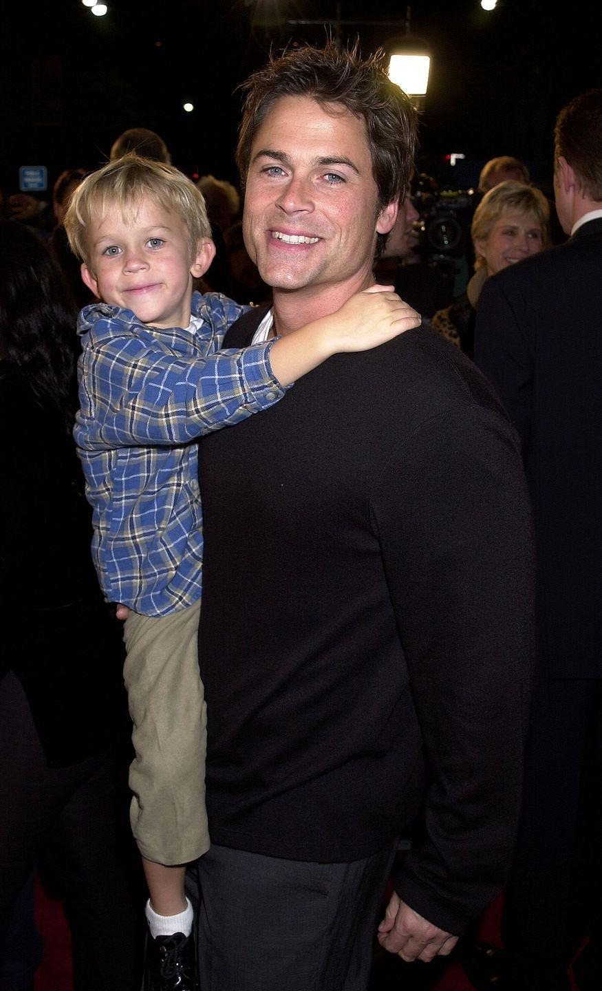 <p>Rob Lowe gives his son, John Owen, a lift at the premiere of <em>Harry Potter and The Sorcerer's Stone </em>in Los Angeles in 2001. </p>