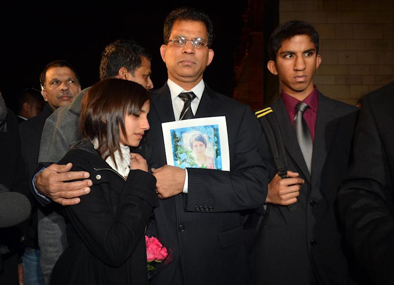 Husband of the late nurse Jacintha Saldanha, Benedict Barboza arrives at the Houses of Parliament in central London with daughter Lisha, 14, and son Junal, 16, for a meeting with a British Member of Parliament  about Jacintha Saldanha's death Monday Dec, 10, 2012. Saldanha was found dead in central London on Friday, Dec. 7, 2012. Australian radio hosts managed to impersonate Queen Elizabeth II and Prince Charles and received confidential information about the Duchess of Cambridge's medical condition, in a hoax phone call to the King Edward VII hospital where the pregnant Duchess was staying and which was broadcast on-air. The controversial prank took a dark twist three days later with the death of nurse Saldanha, a 46-year-old mother of two, who was duped by the DJs despite their Australian accents.(AP Photo /Anthony Devlin/PA) UNITED KINGDOM OUT