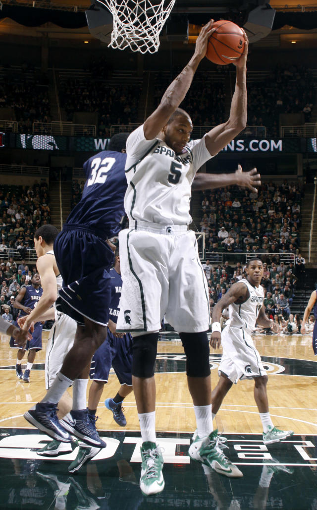 Michigan State's Adreian Payne (5) grabs a rebound against North Florida's Demarcus Daniels (32) during the second half of an NCAA college basketball game, Tuesday, Dec. 17, 2013, in East Lansing, Mich. Michigan State won 78-48. (AP Photo/Al Goldis)