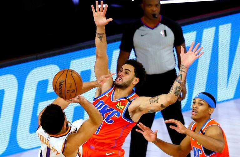 Oklahoma City's Abdel Nader defends against Phoenix's Devin Booker during the Thunder's defeat