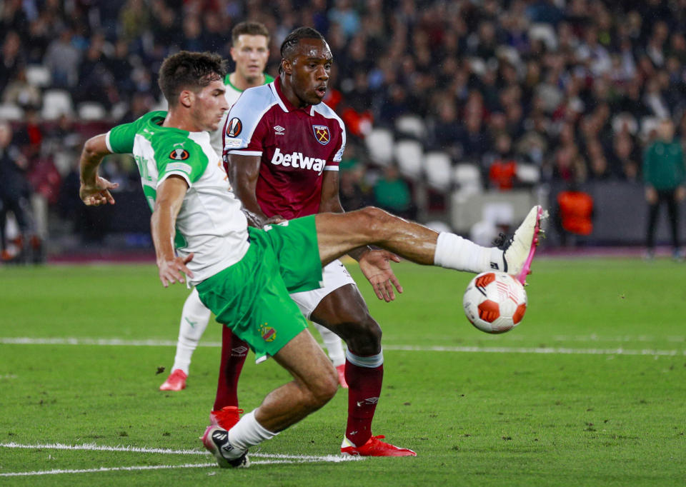 West Ham's Michail Antonio watches as Rapid Vienna's Leo Greiml, left, clears the ball during the Europa League Group H soccer match between West Ham and Rapid Vienna at London Stadium in London, Thursday, Sept. 30, 2021. (AP Photo/Ian Walton)