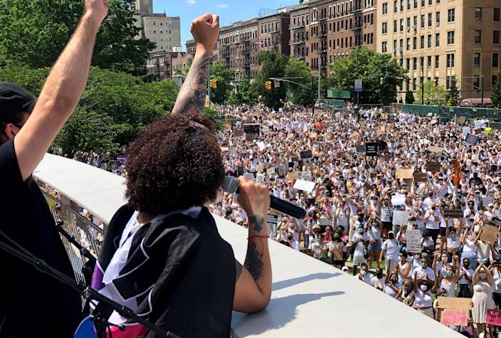 Image: The sister of Layleen Polanco, a transgender woman who died in Rikers Island Jail last year, speaks to a crowd gathered outside the Brooklyn Museum for a rally and march for Black transgender lives on June 14, 2020. (Sekiya Dorsett)