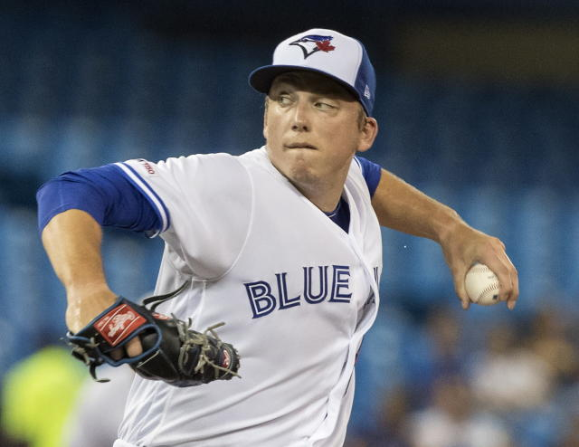 Toronto Blue Jays starting pitcher Ryan Borucki throws against the Cleveland Indians during first-inning baseball game action in Toronto, Monday, July 22, 2019. (Fred Thornhill/The Canadian Press via AP)